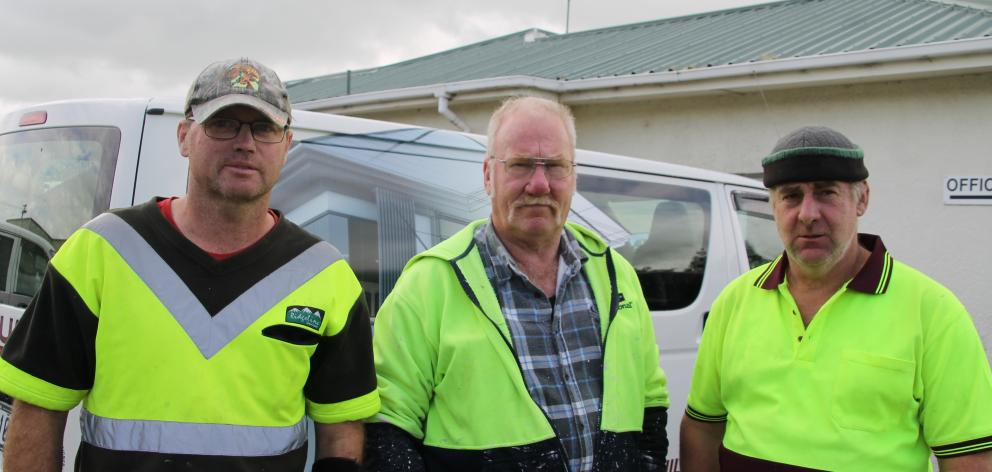 The Brumby Builders team is happy to be home after being saved from the flooding (from left) builder Gary Ward, painter Dave Webster and builder Russell Jenkins. Photo: Kayla Hodge