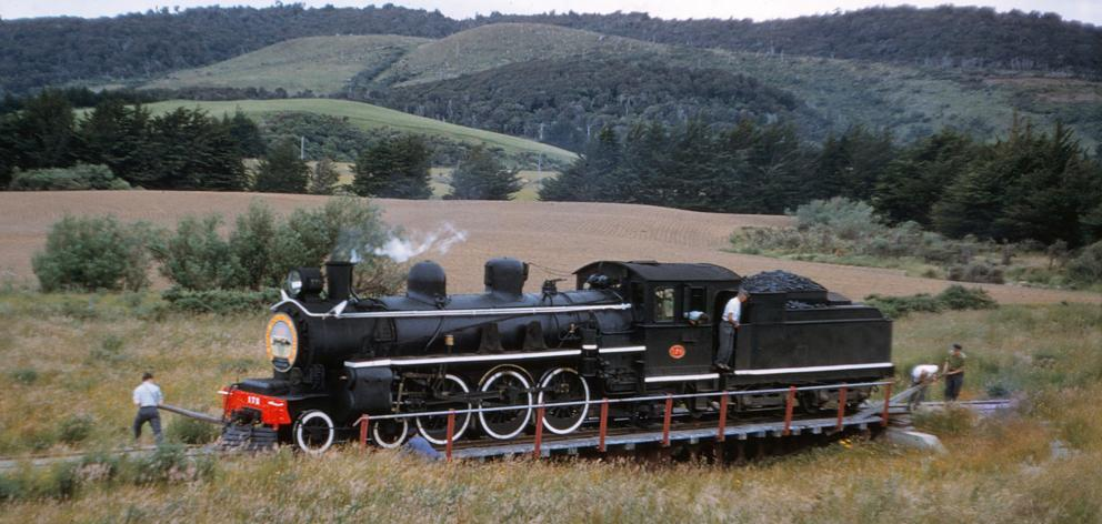 Railway workers shift the train around at the end of the line turntable at Tokanui in 1960.PHOTO:...
