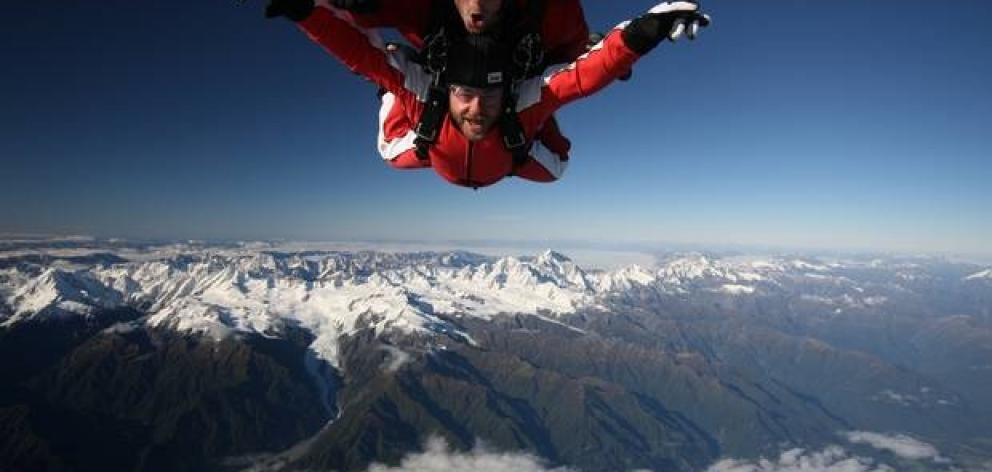 Skydivers and a helicopter were briefly on a collision course over Franz Josef Aerodrome in...
