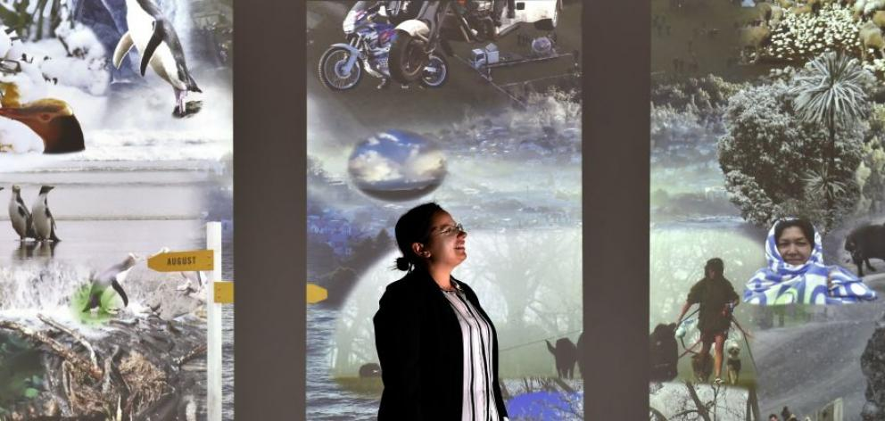 Otago Museum planetarium producer Oana Jones visits the museum's  Beautiful Science Gallery, which has  just won a national award and includes extensive use of Otago Daily Times photographs. Photo by Peter McIntosh