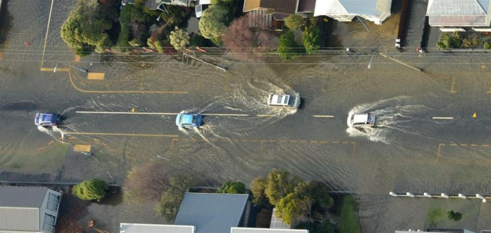 Cars create a wash along a flooded Bay View Rd, Dunedin, during the June 2015 floods. Photo by Stephen Jaquiery.