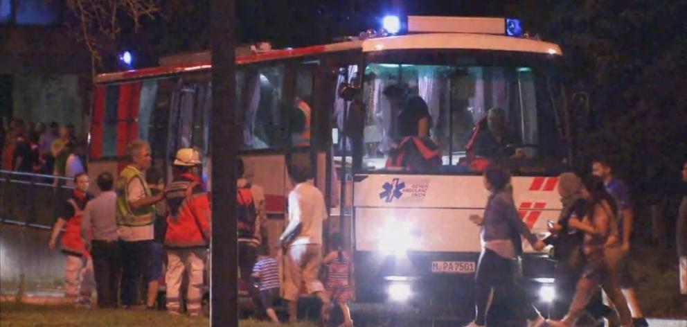 A screen grab taken from video footage shows people being evacuated onto a bus following a shooting rampage at the Olympia shopping mall in Munich, Germany. Photo from Reuters