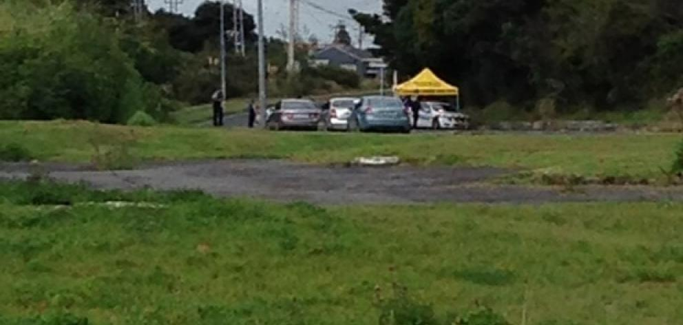 Police have erected a cordon on Triangle Road in Massey. Photo / Tristan Parsons