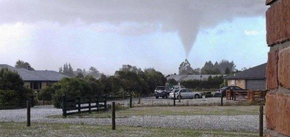 A tornado can be seen in the skies above Leithfield, North Canterbury. Photo / Hurunui District Council
