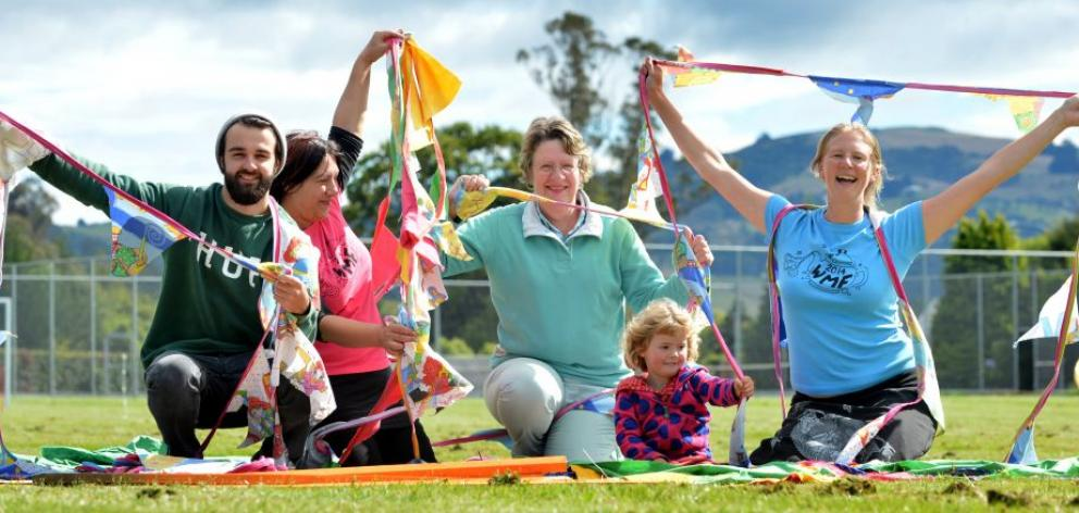 Waitati Music Festival organisers (from left) Thys van Scharen, Tania Turei, Lynda Peppercorn, Emily Peppercorn (3) and Katie Peppercorn play with some of the festival's decorations while setting up at Bland Park, in Waitati, yesterday. Photo by Peter McI