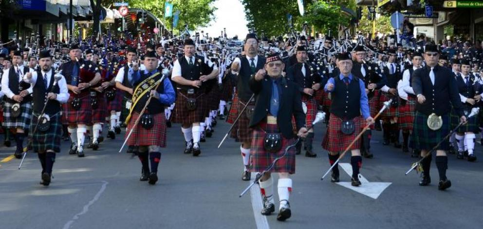 Waimatuku Southern Scenic Highland Pipe Band drum major Russell Baker leads a mass pipe band parade down George St from the Octagon on Saturday. Photo by Peter McIntosh.