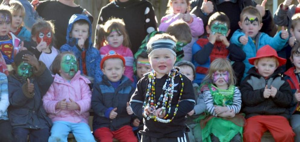Xavier Michelle wears his ''beads of courage'', backed by playmates at Reid Park Kindergarten's dress-up fundraiser day yesterday. Photo by Peter McIntosh.