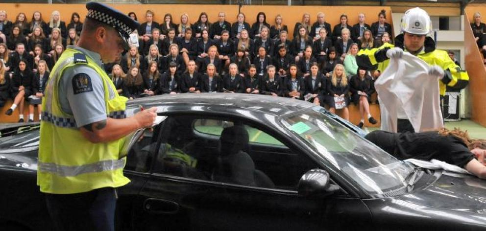 Pupils from Otago  Girls' High School, Maniototo Area School and Lawrence Area School watch as emergency services demonstrate the realities of a car crash. Photo by Craig Baxter.