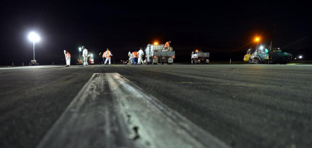 Fulton Hogan contractors work to upgrade the Dunedin International Airport runway earlier this week. Photo by Stephen Jaquiery.