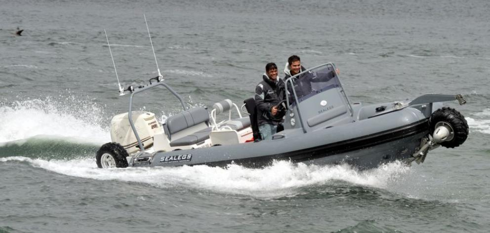 David McKee-Wright (left) and Warren Farr arrive at the Otago Yacht Club on their Sealegs amphibious craft yesterday. Photo by Stephen Jaquiery.