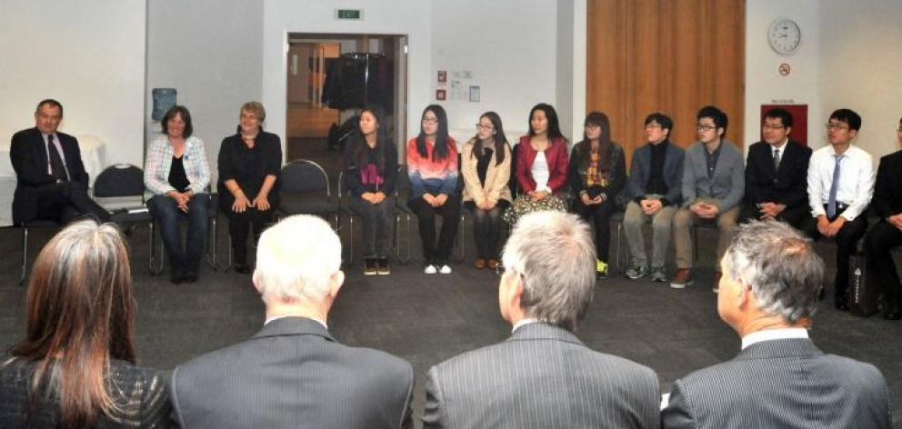 A group of Chinese tertiary students on scholarships from Shanghai is welcomed to Dunedin by members of the Dunedin City Council, local iwi and education providers on Thursday. Photo by Gregor Richardson.