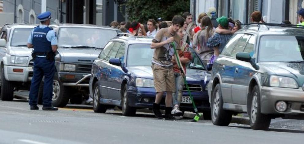 Police attend a large student party on Stafford St, Dunedin,  yesterday. Photo by Craig Baxter.