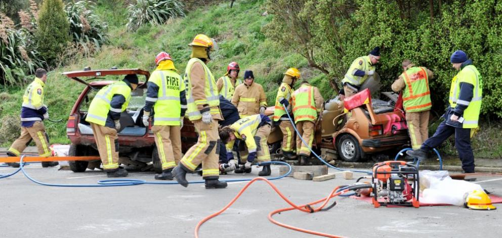 Firefighters from Willowbank, Lookout Point, Mosgiel and St Kilda stations take part in a training exercise cutting ''patients'' from vehicles in a simulated motor vehicle accident beside the Carisbrook site in Dunedin. Photo by Linda Robertson