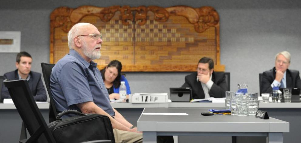 Robert Wyber calls for more co-ordination of bus services as Otago Regional Council staff listen during the draft regional public transport plan hearing at the regional council's council chamber yesterday. Photo by Gregor Richardson.