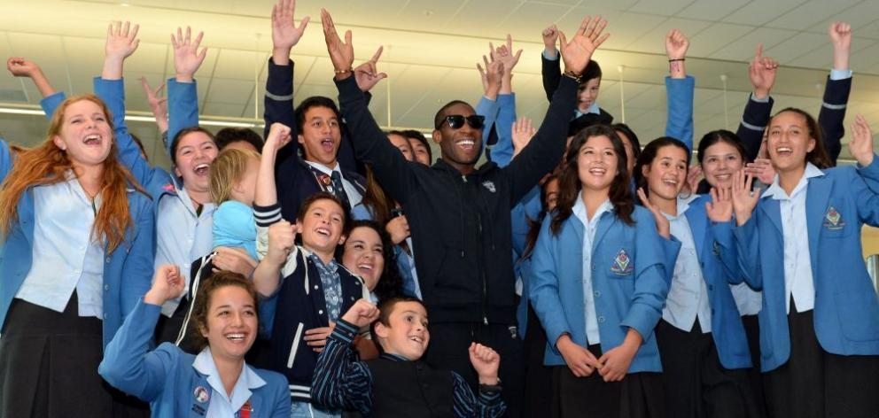 English rap artist Tinie Tempah is all smiles as he is surrounded by the King's and Queen's High School kapa haka group at Dunedin International Airport yesterday. Photo by Peter McIntosh.