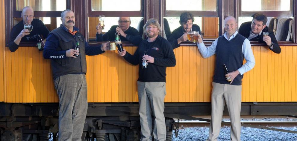Craft beer brewers (from left) Kelly Lindsay (of Green Man), Dennis Trembath (of Speight's), Gavin Duff (of McDuffs), Richard Emerson (of Emerson's), Bart Acres (of Velvet Worm), Dunedin Craft Beer Expo organiser Matthew Black and Taieri Gorge Railway bus