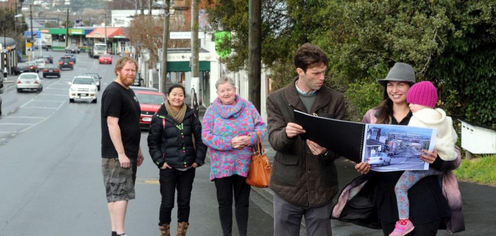 Chasing paint for a mural project are (from left) Caversham Community Group member Gavin Mockford, Presbyterian Support Otago social worker Noora Frantz and group members Sandra Jones, Guy Howard-Smith and Aroha Novak holding daughter Tigerlily (2). Photo