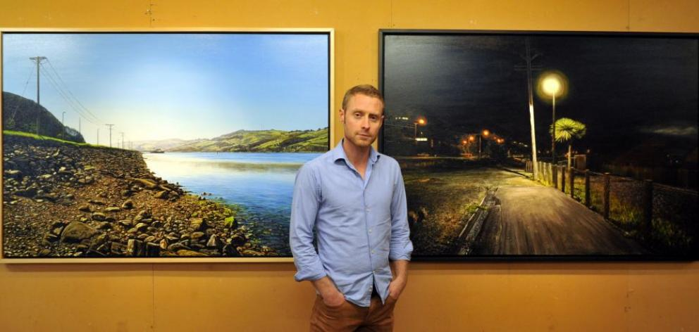 Dunedin artist Sam Foley with two of the artworks in his coming exhibition. Photo by Gregor Richardson.