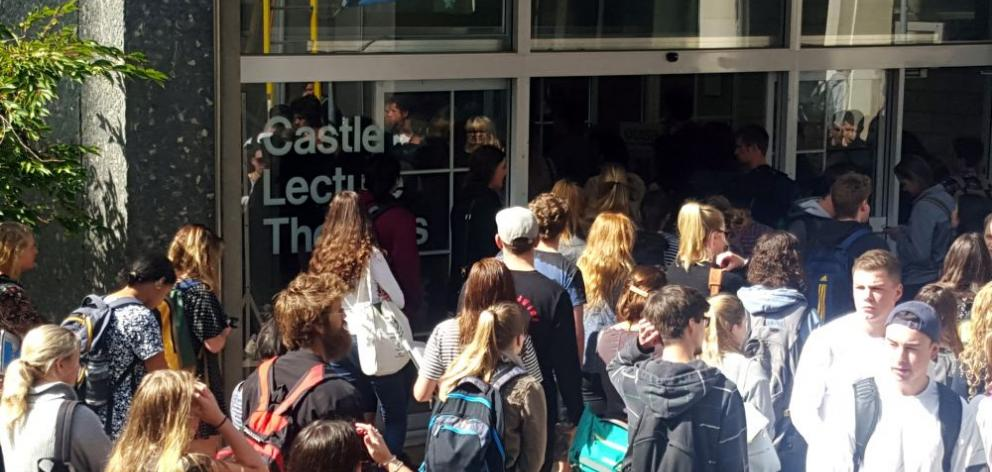Students locked in an infinite chain of causality crowd into the Castle St lecture theatre. Photo: David Loughrey