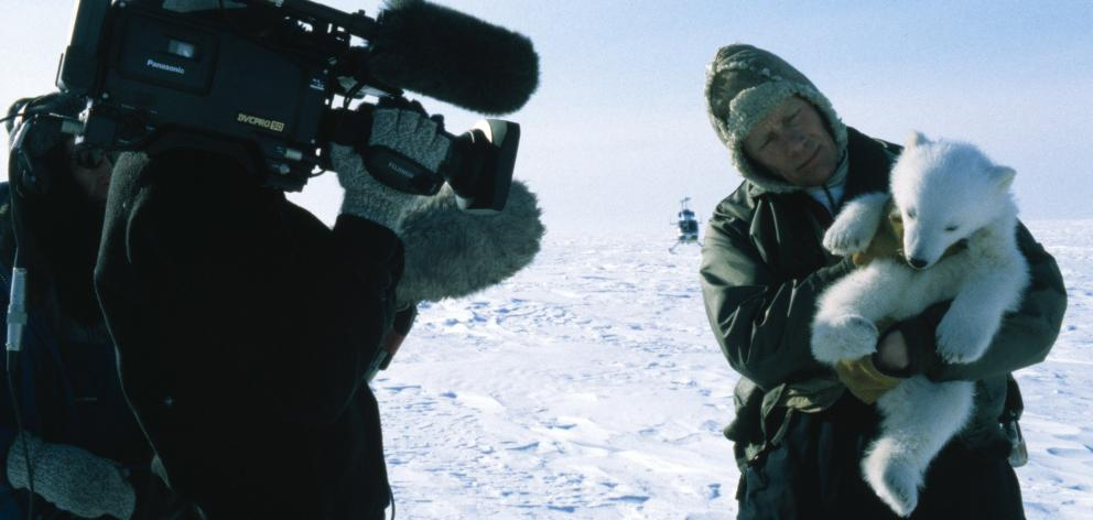 Quinn films research scientist Steve Amstrup and a polar bear cub on the Arctic sea ice. PHOTO: SUPPLIED