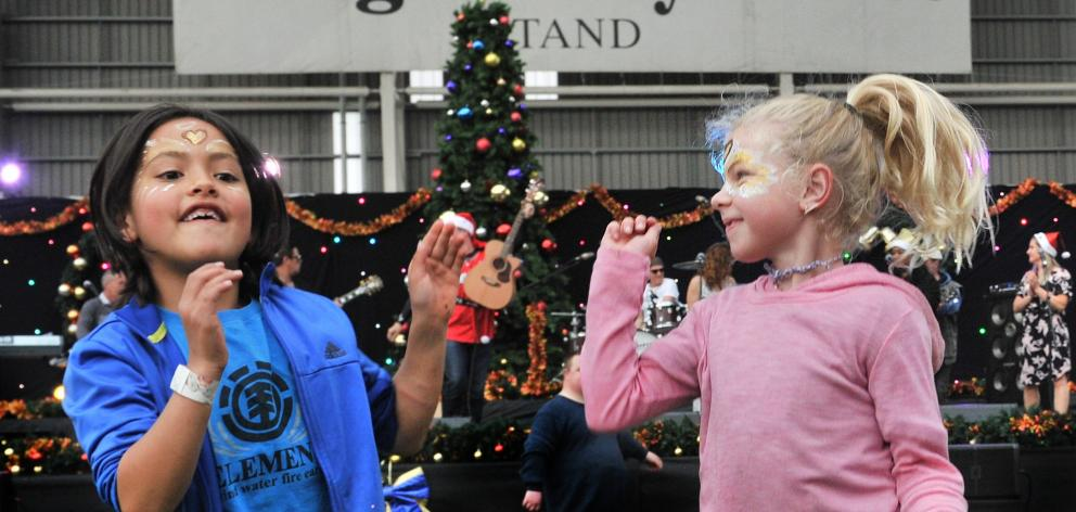 Zoe Turner (7) and Evah Vorgers (8), of Dunedin, dance to the Oxo Cubans.