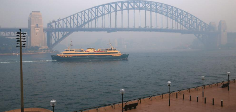 Smoke shrouds the Sydney Harbour Bridge on Thursday. Photo: Getty Images