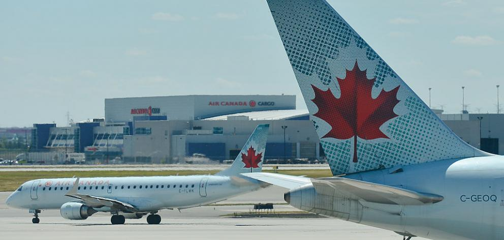 Air Canada confirmed a passenger had been left on the plane and it was investigating how this...