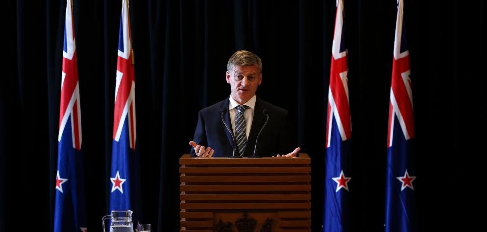 New Zealand Prime Minister Bill English speaks at a press conference at Parliament earlier this year. Max Harris says we should expect more from those that  we install in Wellington. Photo: Getty Images