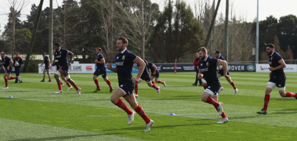 The Lions warm up during a training session in Hamilton. Photo: Getty Images