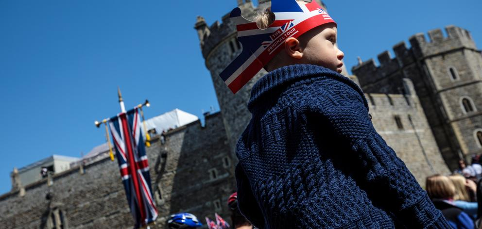 Police are expecting more than 100,000 people to throng the streets outside the castle, the Queen...