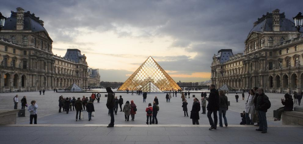 A late-night visit to the Louvre is ideal if you want to avoid big crowds. Photo: Getty Images