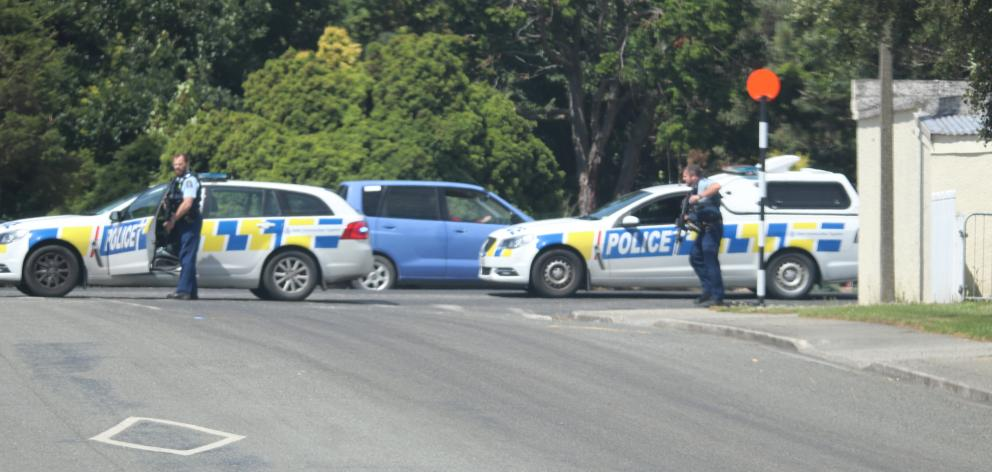 Officers on corner of Oxford St and Wentworth St this afternoon. Photo: Fiona Ellis