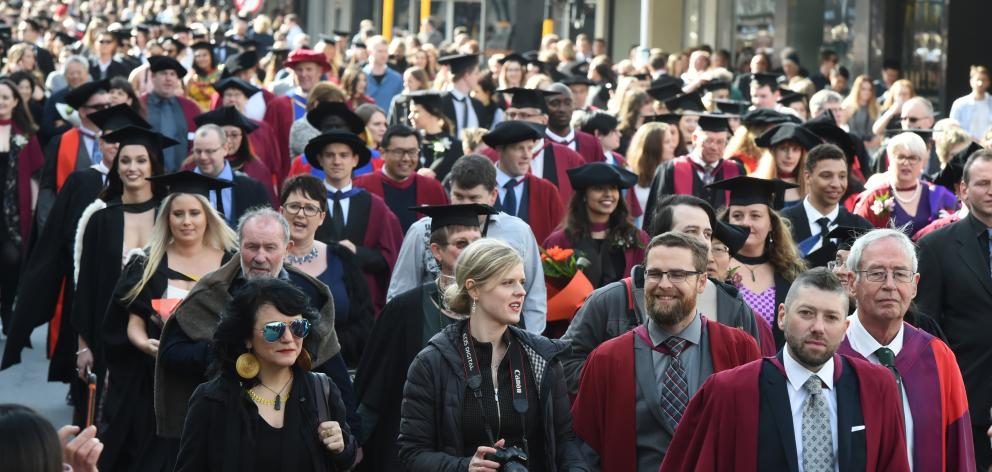 A graduation parade makes its way down George St in Dunedin. Photo: ODT files