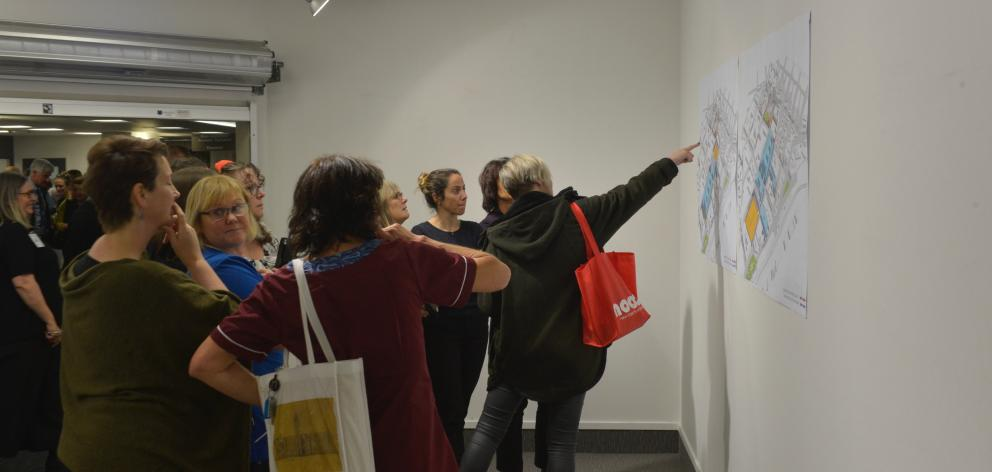 Members of the public look at a map highlighting the area for the Dunedin Hospital rebuild. Photo: Gerard O'Brien