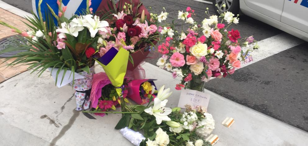Flowers at the police cordon near the mosque in Deans Ave this morning. Photo: Gregor Richardson