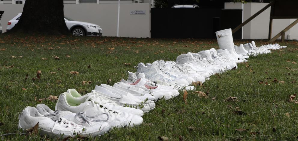 Fifty pairs of white shoes were lined up as a memorial to the victims in Christchurch. Photo: AP