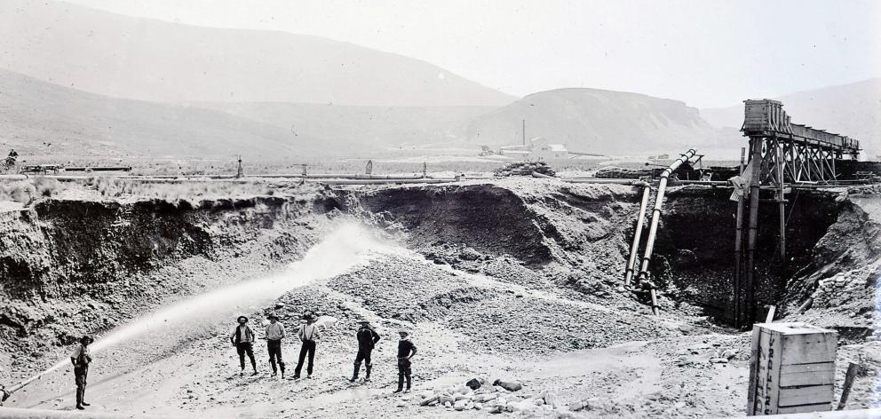 Elevator and crew working Bob McDonald's claim in the Upper Nevis in the early 1900s. In the...