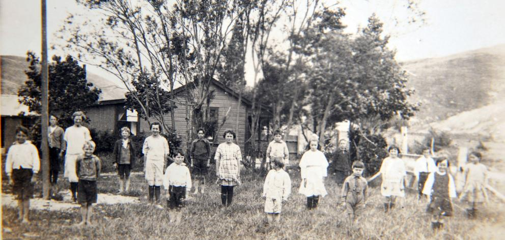 The Nevis School and its pupils in 1924 or 1925. Lessons were held in a converted cottage after...