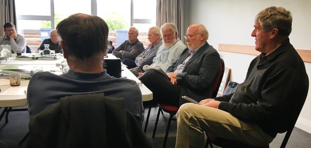 Maniototo farmer Geoff Crutchley (right) talks to past and present Otago Fish & Game Council...