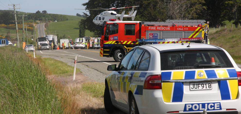 A rescue helicopter lands at the scene of a three-car crash on State Highway 1 at the Moeraki...