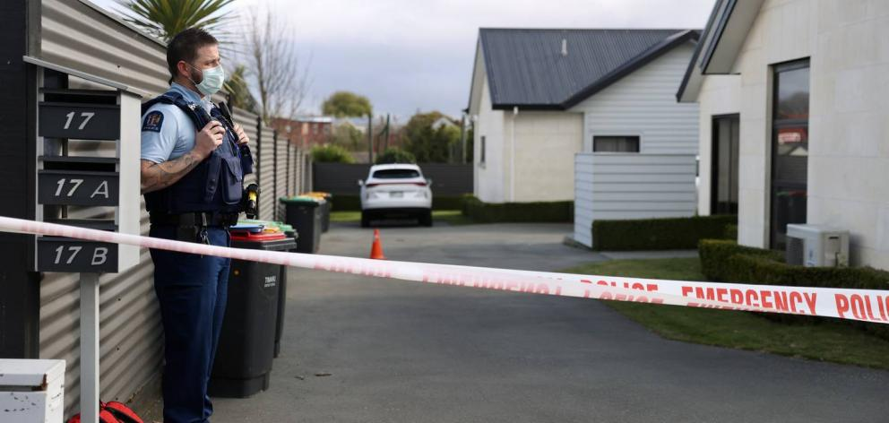 Police stand guard at the scene of the Timaru triple homicide. Photo: George Heard