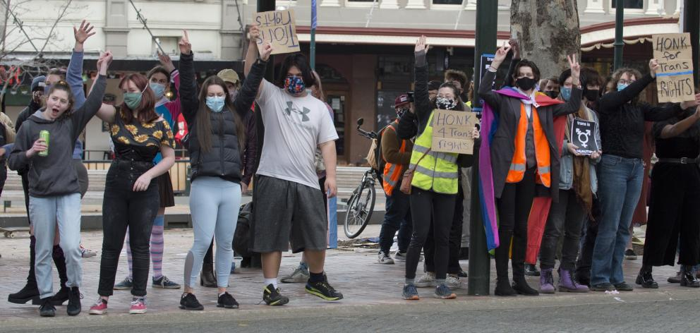 Transgender-positive counter-protesters outnumber the gender-critical feminists on the other side...