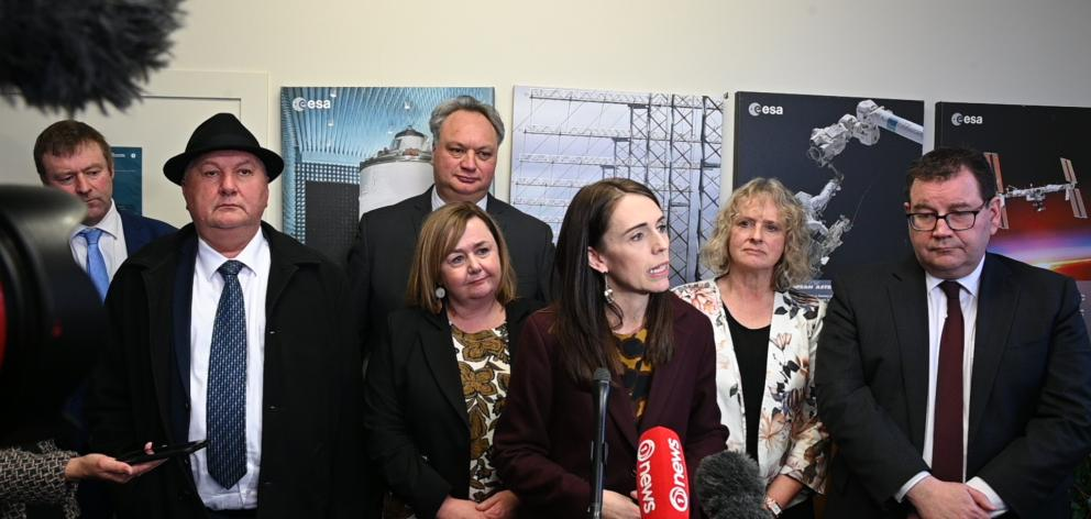 Prime Minister Jacinda Ardern (centre) speaking to media in Invercargill today. Photo: Craig Baxter
