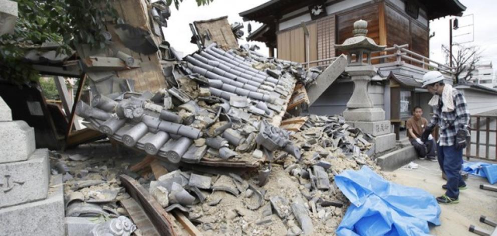 Damaged Myotoku-ji temple caused by an earthquake is seen in Ibaraki, Japan. Photo: Kyodo via Reuters