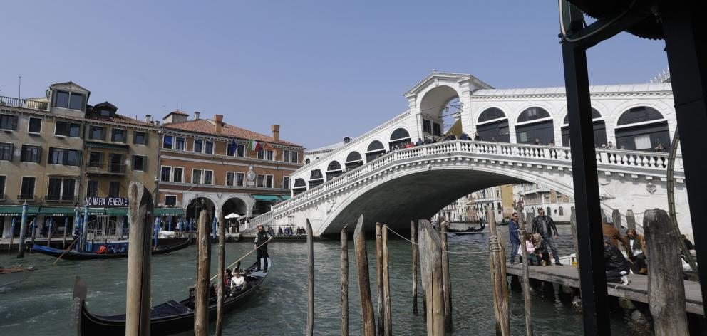 Fashion company Diesel has helped fund improvements for the Rialto bridge in Venice. Photo: AP