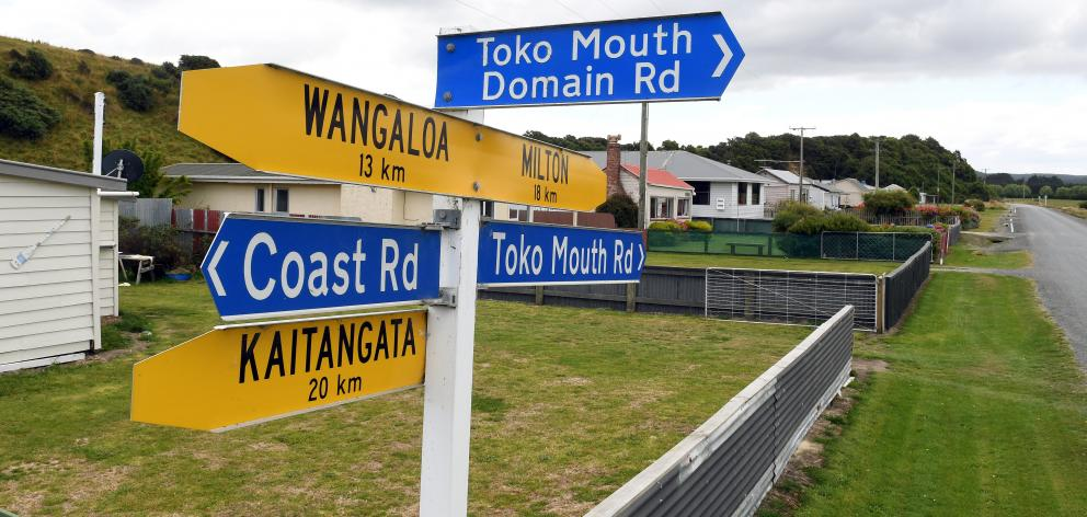 Signposts at Toko Mouth give directions to nearby towns.