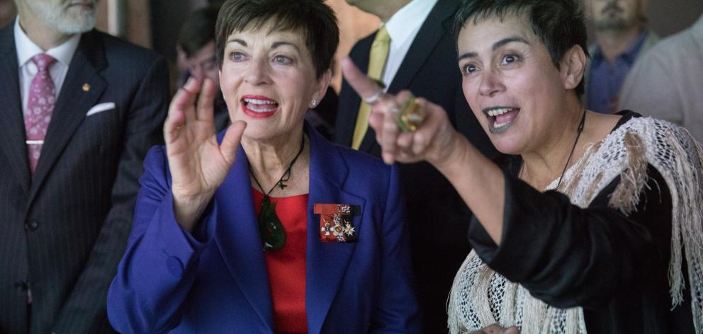 Lisa Reihana explains her work to Governor-General Dame Patsy Reddy at the opening of Lisa Reihana: Emissaries