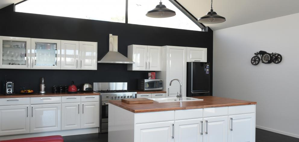 High-level glazing floods the kitchen with natural light while giving privacy from neighbouring...