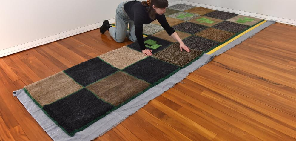 Megan Brady makes carpet in her Stuart St studio.