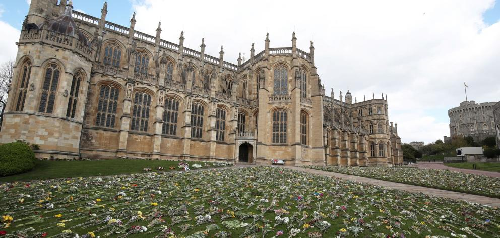 Flowers outside St George's Chapel where Prince Philip's funeral will be held on Saturday. Photo:...